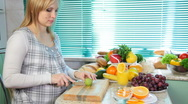 Stock Video Footage of Pregnant woman preparing fruit salad