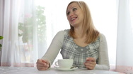 Stock Video Footage of Pregnant Woman relaxing with Cup of Tea
