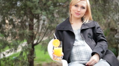 Pregnant woman drinking orange juice Stock Footage
