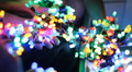 Colorful LED throwies in hands - many colorful bundles in many hands Footage