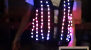 LED vest lights up while being worn during festival - 2 Stock Footage