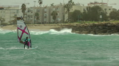 Windsurf storm riders in Mediterranean Sea. Fast approach to the shore. Stock Footage