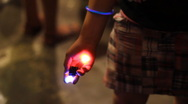 Colorful LED throwies in hands - ready for tossing red and blue Stock Footage
