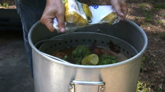 Adding corn to pot Stock Footage