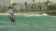 Windsurf storm riders in Mediterranean Sea. Slow Motion. Approaching the shore. Stock Footage