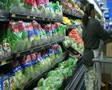 Woman Stocking Lettuce In Produce Footage