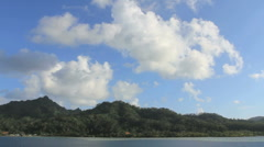 Clouds above a tropical island Stock Footage