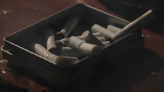 Dirty Ash Tray full of Cigarettes Stock Footage