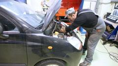 Man repair engine Stock Footage
