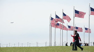 The Washington Monument's flags waving in the wind. (1) Stock Footage