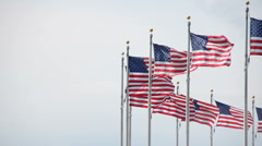 The Washington Monument's flags waving in the wind. (2) Stock Footage