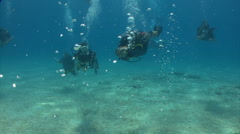 Scuba Divers swimming and spinning  Stock Footage