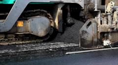 Preparing asphalt for paving Stock Footage