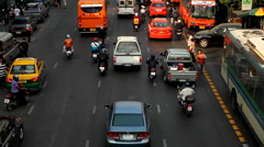 The Bustling Street Scene Of Bangkok, Thailand, Ratchaprasong, Colourful Cars Stock Footage