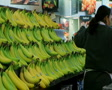 Woman Stocking Bananas Footage