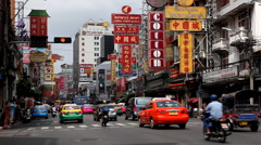 The Bustling Street Scene Of Bangkok, Thailand, China Town, Colourful Cars Stock Footage