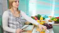 Stock Video Footage of Pregnant woman preparing fruit salad
