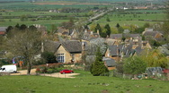 Stone thatched and tiled cottages in a village in Northamptonshire England Stock Footage