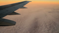 Clouds and Plane Wing at Sunset GFHD Stock Footage