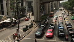 Bangkok exotic traffic with cars and motor scooters in front of intersection Stock Footage