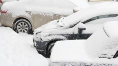 Cars in snow storm Stock Footage