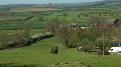 Pan along the Welland Valley to a village in Northamptonshire England Stock Footage