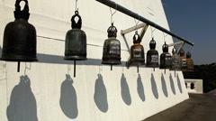 Man Ringing the Lucky Big Bells, Wat Saket in Bangkok, Thailand, Golden Mountain Stock Footage