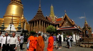 Buddhist Monks in Grand Palace Bangkok People Tourists Visiting Walking Praying Stock Footage