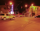 4K FIlm 24p - Night city traffic from the middle of a Y intersection Stock Footage