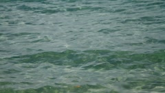 Emerald green colored waves on surface of ocean in Thailand Island  Stock Footage