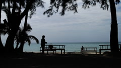 Landscape of women spending time on tropical beach in Thailand Island Stock Footage