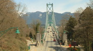 Lions Gate Bridge Vancouver Traffic with Snowy Mountains Stock Footage