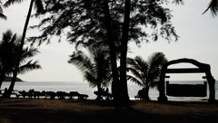Beautiful tropical beach landscape with people resting in Island Stock Footage