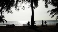 People enjoying time in beautiful exotic tropical beach in island Stock Footage
