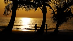 Healthy young couple on exotic tropical beach shore island at beautiful sunset Stock Footage