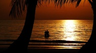 Stock Video Footage of Healthy young couple in beautiful calm ocean on exotic tropical beach at sunset