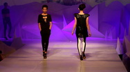 Fashion models walking up and down the runway Stock Footage