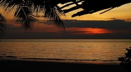 Beautiful landscape of exotic tropical beach at dazzling sunset in island resort Stock Footage