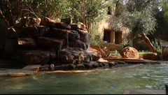 Small artificial waterfall and pool (dark version) Stock Footage