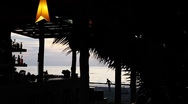 Exotic scene of romantic bar on beautiful tropical beach at colorful sunset Stock Footage