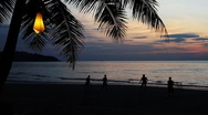 Men playing soccer on beautiful tropical beach in Island at romantic sunset Stock Footage