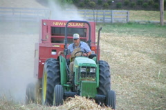 Farmer Baling Hay Stock Footage