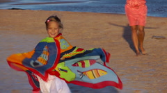 Girl with her ​​mother played on the beach Stock Footage