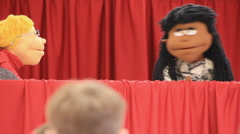 Puppets talking during a skit while children watch (HD) c Stock Footage