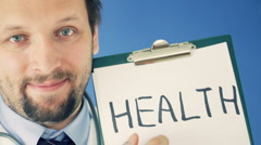 Male doctor showing clipboard with HEALTH word, on blue background HD Stock Footage