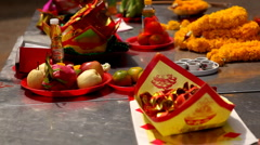 Offerings of fruits, candy are placed on the altar for the various gods, spirits Stock Footage
