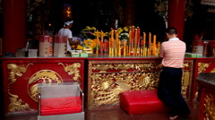 Chinese People Praying, Worship, Red Gold Candle, The Chinese Temple, China Town Stock Footage
