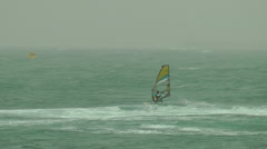 Windsurf storm riders in Mediterranean Sea. Rotation in the water. Stock Footage