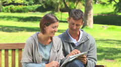 Young couple doing crosswords together Stock Footage