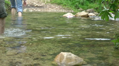 Kziv river at spring. Passage across the river. - stock footage